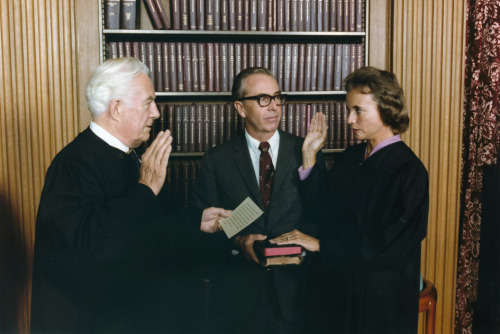 coolchicksfromhistory:  September 25, 1981 Sandra Day O'Connor is sworn in as Supreme Court Justice by Chief Justice Warren Burger, her husband John O'Connor looks on. Raised on an Arizona cattle ranch, Sandra was the first woman to serve on the Supreme Court.  She stepped down from the bench in 2006 but occasionally serves as a substitute judge in federal appellate courts.  Sandra is also involved with civics education though iCivics. Arizona State University renamed its law school the Sandra Day O'Connor College of Law in 2006.