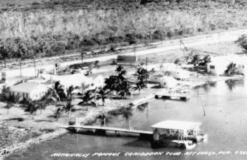 The Caribbean Club, Key Largo, 1950s. The Caribbean Club was the last thing built by auto parts and real estate promoter Carl Fisher. Opening in 1938, it served as a poor man's fishing retreat. In 1947, Warner Brothers used the site for exterior shots in the Humphrey Bogart and Lauren Bacall film Key Largo. It has been owned and operated by the Whitehurst family since 1963. Source: Florida Memory Project