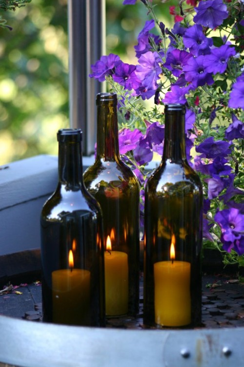 Repurposed wine bottles, as candle lanterns.