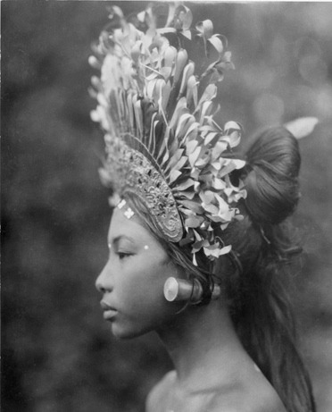 "kawaiih0re:   A towering headdress and plug earrings adorn a 1930s Balinese djanger dancer, part of a coed performance that was ""more of popular fun than of temple dance or disciplined art,"" wrote Maynard Owen Williams in his March 1939 Geographic article, ""Bali and Points East."" The dance's male participants ""at times resemble a troupe of cheer leaders made up like Groucho Marx,"" noted Williams. ""Syncopated movement, swaying forms, flashing fingers, and glittering crowns in high relief against deep shadows under the banyan tree—such is the djanger."" — Margaret G. Zackowitz  from National Geographic Magazine"
