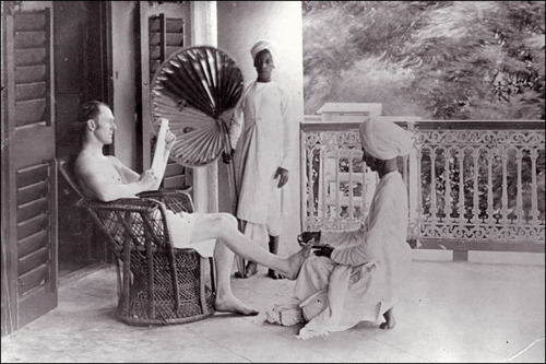 European man receiving pedicure from South Asian servants