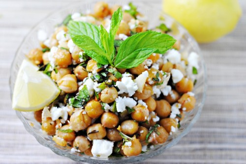 Garlicky Roasted Chickpeas with Feta and Mint Garlicky roasted chickpeas with feta and mint - the perfect quick, healthy, vegetarian side  1 15-ounce can chickpeas (garbanzo beans), rinsed and drained 1 tablespoon olive oil 3 cloves garlic, finely minced ¼ teaspoon red pepper flakes Salt Freshly ground pepper ¾ cup crumbled Feta ½ cup chopped fresh mint Lemon wedges from: www.katherinemartinelli.com