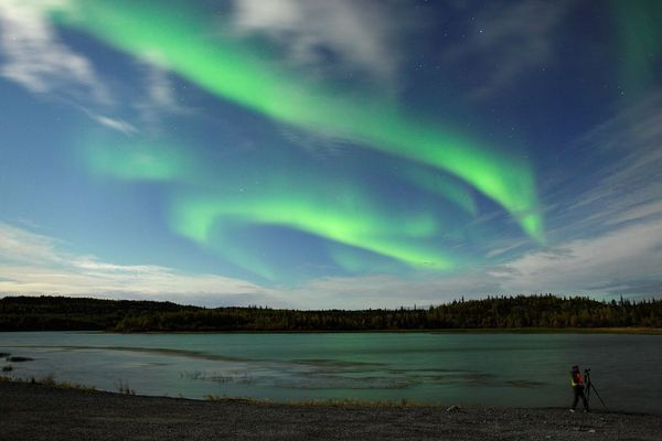 "Auroral curtains swirl over Canada's Northwest Territories in a picture taken early Monday morning. ""This image was taken at Prosperous Lake on September 12 before 3 a.m., when the harvest moon was shining from the left side of the frame,"" photographer Yuishi Takasaka said via email."