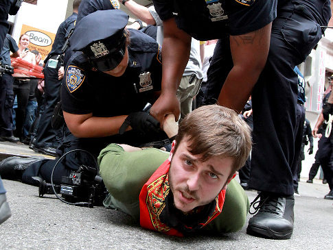 leftish:  A man is arrested on 12th Street near Union Square. Dozens were  arrested after a march from the Occupy Wall Street encampment in lower  Manhattan.  We imagine most people reading this currently have the same look on their face as this protester did when he was arrested. Again, why is this necessary?