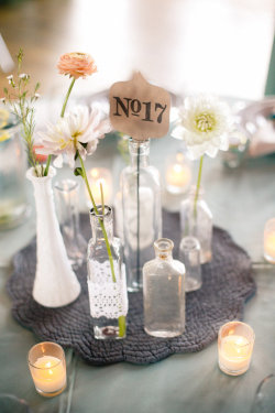 Lovely wedding centerpiece.  The doily crochet around the front bottle is magnificent.