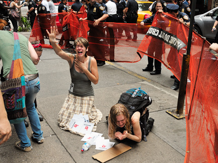 babyvomit-:  The peaceful Occupy Wall Street protest march turned violent as the NYPD corralled and pepper sprayed the participants. Mass arrests were made and loaded onto a NYC bus further locking traffic. The protest march took a route from Zuccotti Park to Union Square on East 14th Street. The protesters were marching back to Zuccotti Park when the NYPD turned violent. Hitting, arresting and forcing protesters into a small area. At that point a NYPD supervisor yelled shut up to one of the protesters and shot pepper spray into her eyes point blank range and hitting a half dozen protesters (including 3 police officers) when they had nowhere to go. The same supervising officer was seen (photographed) laughing after the arrests while looking at his text messages.