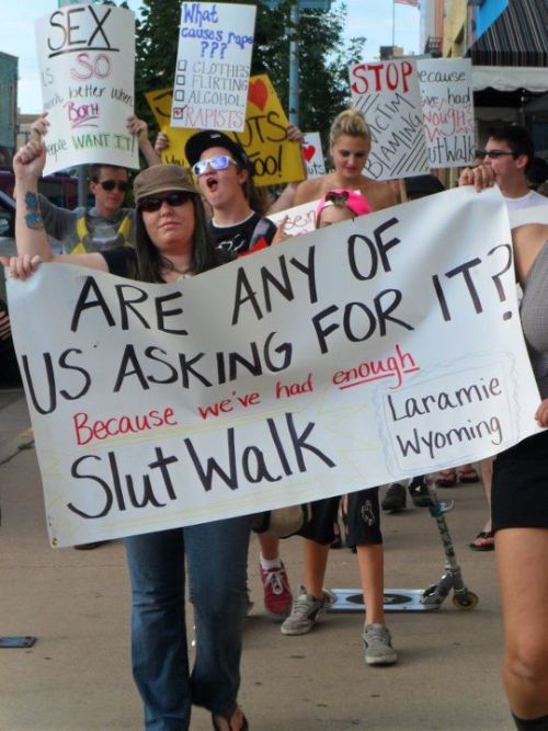 "cognitivedissonance:  Me, with others at the UW Slut Walk 2011. I'm wearing sunglasses and the olive hat. Thanks to Safe Pokes for taking a great photo! There was a turnout of roughly 100 in Laramie. The group was also quite diverse. Afterwards, we came back to campus and enjoyed live burlesque and vocal performances. The reaction was fairly positive - we even elicited cheers and clapping when we walked by a barbecue at St. Lawrence Catholic Church. I was thrilled to see so many people come out to support it. Women's Action Network organized Slut Walk partially in response to an ASUW Senator Noah Hull's remarks in reference to sexual assault. I wrote a letter condemning his remarks, as did others, and he apologized. He references a comment, since deleted, written about me on the website within his letter:  Comment: ""Looks like Meg Lanker wasnt getting enough attention lately so she had to make up a rape story. I want the Branding Iron to publish the entire police report and any medical documents. She should proove it because theres nothing but her word and you know how liberals/terrorists lie about everything. Its so co-incidental that theres nothing to fact check huh. I heard she said she got raped on campus. So wheres the news story. I couldnt find anything. UW police said they havent heard anything. its not like anyone would want to rape her anyway, shes a wildabeast. She should be glad someone supposedly wanted to touch her. I like how she changed her name, probably so she wont be assocated with a terrorist. Noah is right. If you dont want to put yourself at risk, dont go out to smoke. You wont put yourself at risk of cancer either. If you dont want to get raped dont act like you want it. I can control myself but some guys cant. You cant control breathing in second hand smoke at all. Go Noah. Stand up to the people who try to whine about smoking being taken away. Maybe if we cant smoke on campus people like Meg Lanker will go away and leave our state alone."" Yeah, a little over the top, bro. So if nothing else, the comments made by Noah Hull, and comments like this one above, provoked a long-needed discussion on the UW campus. I hope to see this dialogue continue."