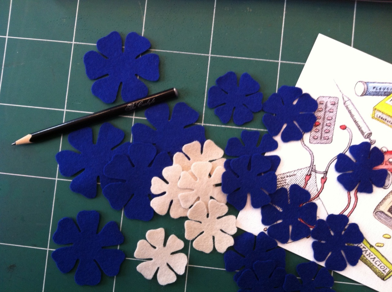 Cutting out felt flowers for the new collection of OLT hairbands.