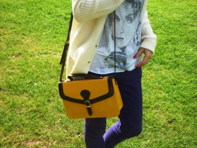 Today I'm Wearing- Primark's Yellow Satchel It's not often that I spend the weekend with my feet off the ground, dangling from a piece of metal whilst being thrown through the air- but alas, this is what I've been up to this weekend as I visited the fun packed Alton Towers! I'm a bit of an adrenaline junkie when I want to be, so it was really fun getting my fix of G-Forces from my favourite British theme park, and boy oh boy was it fun. I had an absolutely fantastic time, and I'd like to thank the one and only AT for putting us up in their hotel for the night! Before I swanned off up north, my creatives juices were working overtime imagining where I could host my latest outfit post. Perhaps I could've captured the moment I got splashed by an ocean on the log flume? Or whilst I was 'flying' through the air on, well- 'Air'? Unfortunately I didn't factor the 'appearances' of rollercoasters into this 'style' equation (bless them, they're not the prettiest of things!) so instead I turned to the beautiful Gardens and Manor House of the park, which posed as a wonderful alternative. I didn't manage to get very many acceptable photos as I was so puffed out from the long day we'd had, but I hope the ones that were captured show how special this Primark bag is- and the little thing was only £7, such a bargain! The bag in question is from the latest A/W'11 collection and is in stores now, and I couldn't recommend it enough! On the way back from Towers we also stopped off at 'Bicester Village', and tomorrow I'm planning on rambling on about the outlet heaven on the Babble- so keep your eyes peeled my lovelies! x   I also wore: Madonna tee from Tee and Cake at Topshop, Knitted cardi from Primark, and purple skinny jeans from Forever 21.
