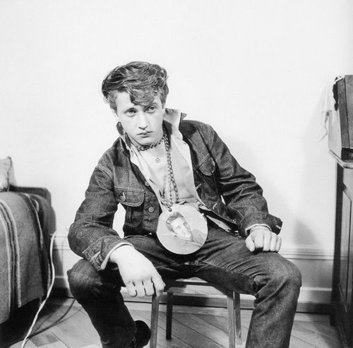theniftyfifties:  A true Elvis fan, 1950s.  Man, he is trying so hard. He got that swagga with our without the giant Elvis necklace thing though.