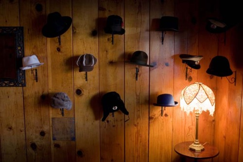 """Hats, Forest House Lodge, Foresthill, CA."" Photo by John Decker."