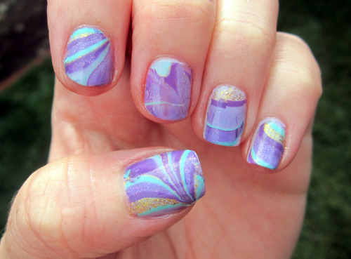 Skipping way ahead to 30 Day Nail Challenge Day 20: Water marble.  (It's a rainy, lazy day at home and I had time to attempt this.) I tried traditional nail water marbling before and I suck at it.  So I tried this dry marbling technique and it worked out pretty good.  It's still something that you need to work at and improve on.  I'm sure if (when) I do this again it'll go much smoother.  Still with the problems I had it was much easier and less stressful than true water marbling. Essie Lilacism (basecoat) China Glaze For Audrey (marble) China Glaze Spontaneous (marble) Sinful Colors I Love You (marble) Wet N Wild The Gold & the Beautiful (marble)