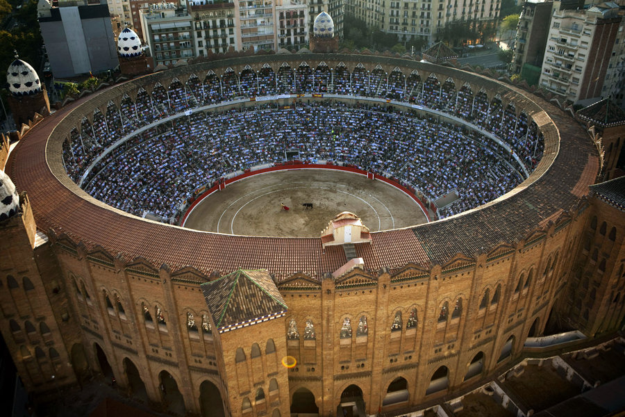 jane-jones:  thedailywhat:  End Of An Era of the Day: 20,000 bullfighting fans packed Barcelona's iconic La Monumental bullring to watch Catalonia's last corrida, headlined by Spain's #1 matador, José Tomás. The regional ban on bullfighting, which was approved last year, officially goes into effect in January. More photos here. Watch a BBC report on the ban below:     [ap via photoblog / nyt / bbc.]  Awesome. No pity for these people. Hope the bull gores as many as he can on his way out.   obvs there's a culture divide but every time i've watched a bullfight i've wanted to puke. it's a horrible, horrible thing. glad that it's banned.
