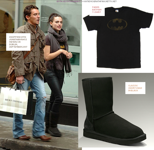 For a shopping trip in Dublin, 2007, with Jonathan Rhys Meyers, Katie wore a faded Batman t-shirt and paired it with classic short Ugg boots.Purchase:Shoes: 1