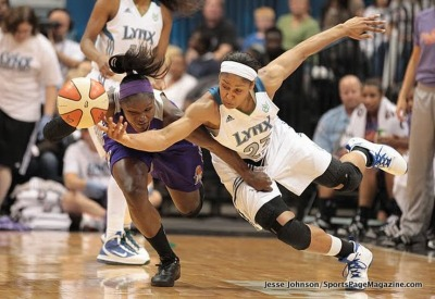 Maya Moore, battling here against Marie Ferdinand-Harris, would not be denied this season in the WNBA, leading the Minnesota Lynx to their first winning season in 7 years and their first even WNBA Finals appearance, starting soon against the winner of the Atlanta Dream-Indiana Fever semifinals series.