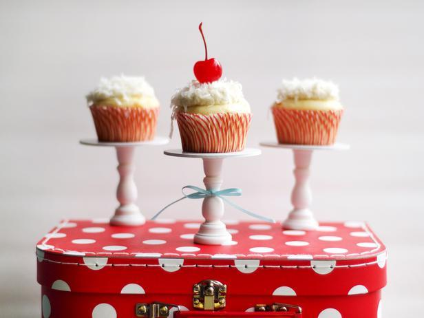 Cupcakes for Everyone  When hosting a small party, serve individual portions of food to add an intimate feel to the table. Cupcakes are always a hit, so why not put them up on the pedestal they deserve! All you'll need to make these mini cupcake stands are candlesticks, wooden circles, wood glue and spray paint. Easy!