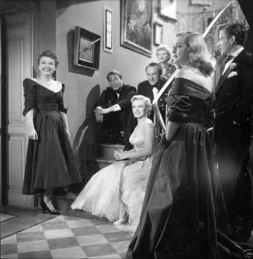 normajeanemonroe:  1950: All About Eve stars Bette Davis and Anne Baxter. Unlike some others of her early career, noteworthy only for her bit parts, All About Eve is worth remembering for all the right reasons. The American Film Institute placed it as number 16 on the 100 Best American Films list in 1998. You can read the films summary here, if you are not familiar with it. Marilyn, who played Miss Caswell (and was still relatively unknown at the time), earned $500 a week, equivalent to $4300 today. Not bad, considering how young and fresh her career was at the time!