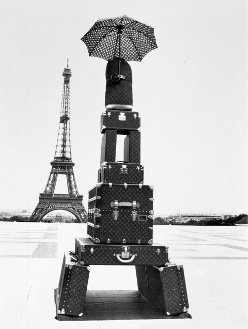 the suitcase tower!  Photo by Jacques Henri Lartigue, originally via.
