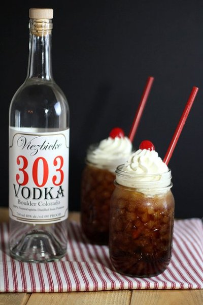 Vootbeer  In a ice filled tumbler  1 1/2 oz 303 Vodka  Top off with Root Beer  Dollop of whip cream