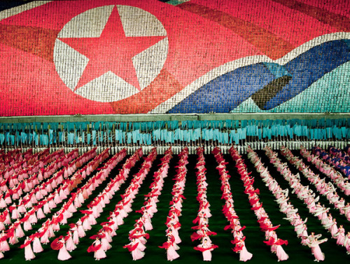 curiositycounts:  Sam Gellman's extraordinary photos of North Korea's Mass Games, meticulously choreographed displays of gymnastics and performing arts with nearly 100,000 participants