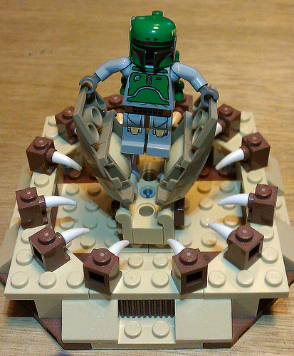 "mattsbrickgallery:  ""Erm…a little help here…anyone…?""   A Lego Boba Fett fending off the jaws of the Sarlacc? INSTANT REBLOG!"