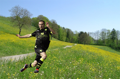 Aidy White frolics in a meadow.
