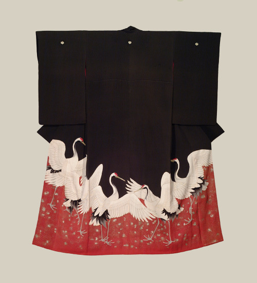 Late 19th century silk kimono featuring an unusual layout of standing cranes, wings outstretched.  The presence of five family crests or 'mon' indicates that this kimono was intended for formal, special occasions