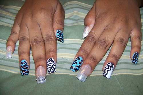 sumwhereinthestars:  myy powder blue / leopard / tribal lookin nails ii had did a few months aqo …