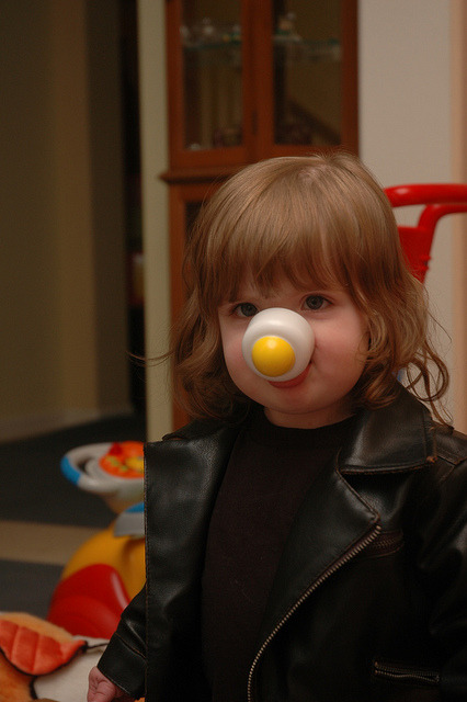 """Are you my Mummy?""   I swear to God the (plastic) egg on her face was her idea. Tonight we checked the Eight and Nine costumes to make sure they weren't tight anywhere. No problems with either of 'em; she's swimming in them both.  As a matter of fact it was opportunity enough to find out what sort of underwear the Ninth Doctor wears under that badass exterior.    Tada! It's Elmo! The Eighth Doctor shots we got weren't anywhere near as amusing, but they were sort of elegant. As elegant as a 20 month old gets, that is.   If you check the video I uploaded of the Eight fitting, you'll see just how obsessed she was with the ""Ock""."