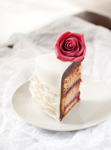 3amcravings:  Vanilla Cake filled with white chocolate raspberry ganache covered with dark chocolate ganache (by Lulu's Sweet Secrets)