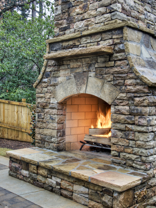 How to Build an Outdoor Stacked Stone Fireplace (via Home & Garden Television)