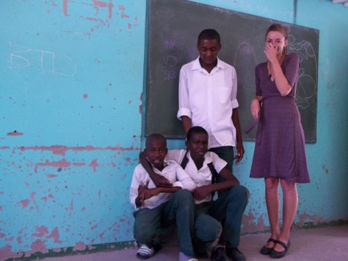 "Probably my favorite ""Teacher Leslie"" photo. I am officially a Namibian woman — covering my mouth — and check out Meninge's face….. :)"