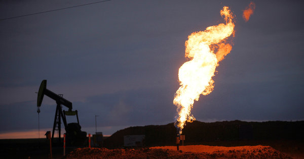 Oil companies drilling for the stuff in places like North Dakota are happy to let perfectly good natural gas — a by-product of the drilling process — go to waste.  From the New York Times:   They are not wildfires caused by lightning strikes or other acts of nature, but the deliberate burning of natural gas by oil companies rushing to extract oil from the Bakken shale field and take  advantage of the high price of crude. The gas bubbles up alongside the  far more valuable oil, and with less economic incentive to capture it,  the drillers treat the gas as waste and simply burn it.   Every day, more than 100 million cubic feet of natural gas is flared  this way — enough energy to heat half a million homes for a day.   The flared gas also spews at least two million tons of carbon dioxide  into the atmosphere every year, as much as 384,000 cars or a medium-size  coal-fired power plant would emit, alarming some environmentalists.   All told, 30 percent of the natural gas produced in North Dakota is  burned as waste. No other major domestic oil field currently flares  close to that much, though the practice is still common in countries  like Russia, Nigeria and Iran.   Yes, by all means, let's trust oil and gas companies to do the right thing. (Photo of natural gas being flared off near Ray, North Dakota by Jim Wilson for the New York Times)