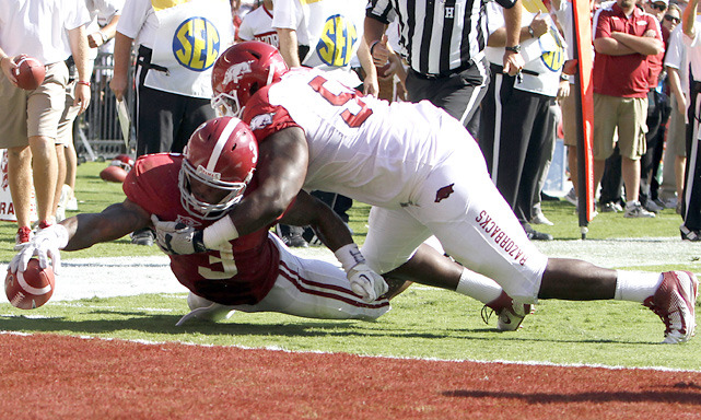 Alabama RB Trent Richardson stretches for the goal line, but comes up short on the stop by Arkansas DT Byran Jones. The Crimson Tide cruised to a 38-14 victory. (AP) STAPLES: LSU, Alabama lead this week's Power RankingsMANDEL: LSU, Alabama set for dream matchupANDERSON: Awards for the best, worst of Week 4ANDERSON: Week 4 in quotesMcCARTNEY: Who's the front runner for the Heisman Trophy?STAPLES: Oklahoma State rallies for special victoryVIDEO: Heisman Watch