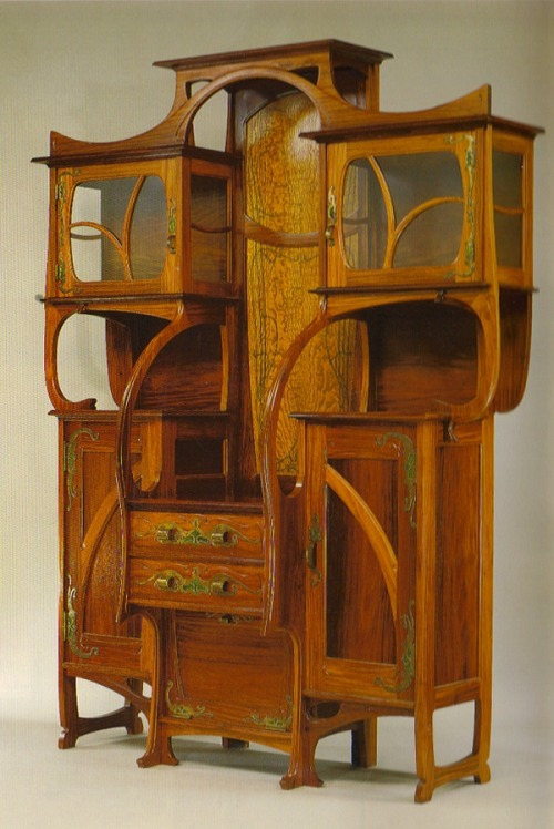 Art Nouveau Cabinet - vitrine made by Gustave Serrurier-Bovy- Belgian architect and furniture designer Red narra and ash with copper and enamel mounts In MOMA in New York City