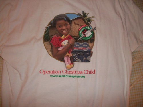 Merry.  Christmas.   I love Samaritan's Purse and Operation Christmas Child!  This shirt came from a trip I made to North Carolina to work in the Samaritan's Purse warehouse to help pack shoe boxes to go all over the world.  These boxes are full of toys, schools supplies, and hygiene items for boys and girls of all ages from all over the world.  I loved stuffed animals as a kid so one of my favorite things to include in the shoe box is a build-a-bear stuffed animal.  It feels my heart with joy to think about a sweet little girl pulling her new friend out of the box.  You should consider putting a box together.  Here's the info: http://www.samaritanspurse.org/index.php/OCC/  My heart beats right with Samaritan's Purse.  The story of the Good Samaritan (Luke 10:30-37) shows us how we are to love the last and the least in the world.  Samaritan's Purse helps meet the needs of people who are victims of war, poverty, natural disasters, disease, and famine with the purpose of sharing God's love through His Son, Jesus Christ.  While I do not know what it is to physically suffer, I do know what it is to be without hope.  Jesus has shown me great love and given me hope and I want to do the same in the lives of others.