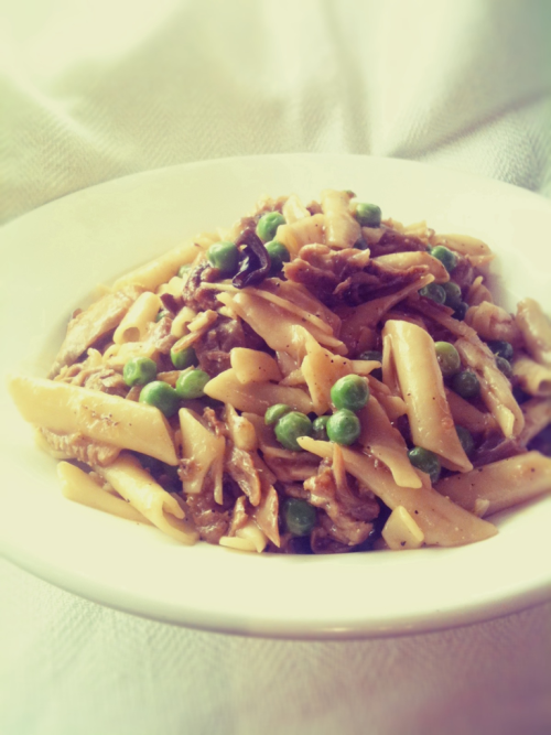 Peking duck penne with peas and wild mushrooms. Once again in the pursuit of sustainability, I am cooking with what many refer to as first world waste products. In times where wealthy countries send so many tonnes of perfectly edible food to landfill, I feel that the pursuit of prime cuts and 'perfect' looking produce is irresponsible when globally there are food shortages. So this time, I've used the carcasses of Peking Ducks taken from a restaurant. I merely asked for them after my meal and the restauranteur happily gave me two. Historically, Chinese culture promotes a no waste, find a way to use everything ethic, so I suppose for them it wasn't an issue. There was enough meat and skin left on just one of the frames for this dish and the bones made a good stock, some of which was used in the sauce.  I also used dehydrated wild mushrooms, adding some of the steeping liquid to the sauce too. It was a restaurant worthy meal and we enjoyed it with a 2003 Penfolds Bin 28 Kalimna shiraz, that enhanced the sprinkle of kampot pepper that I finished the pasta with.