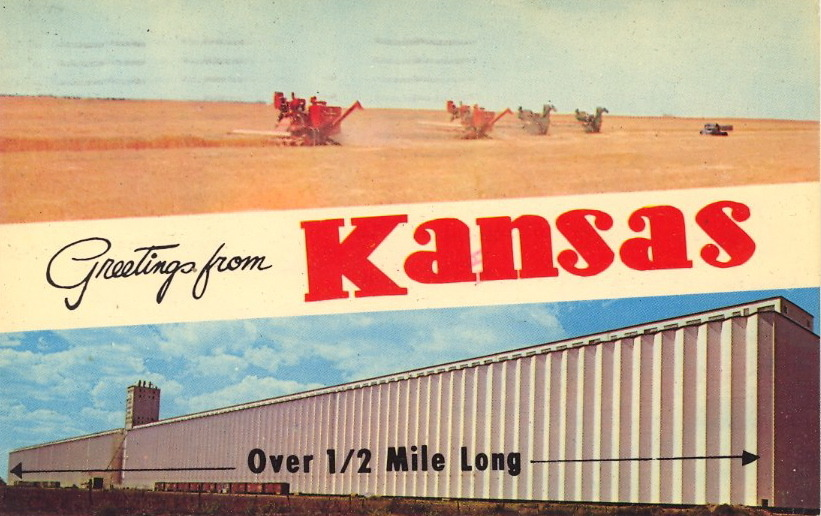 "KANSAS. OVER 1/2 MILE LONG.  GREETINGS FROM KANSAS Some of the World's largest grain elevators are located in Kansas, the nation's producer of wheat. It is known as the ""Bread Basket of the World."""