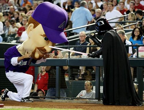 "siphotos:  Diamondbacks ""Legend"" Mark Grace is stopped by Darth Vader on Star Wars  Day during the game against the Giants on Monday at Chase  Field. (Christian Petersen/Getty Image)  GALLERY: Star Wars and Sports"