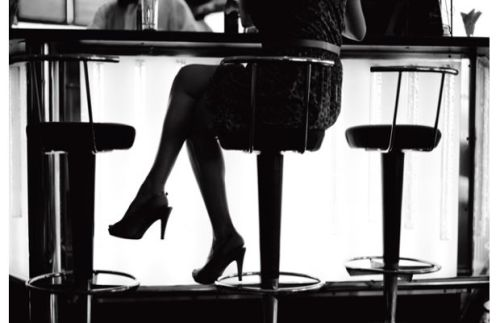 She sat at the bar, thinking about what she left behind and what she needed to buy.