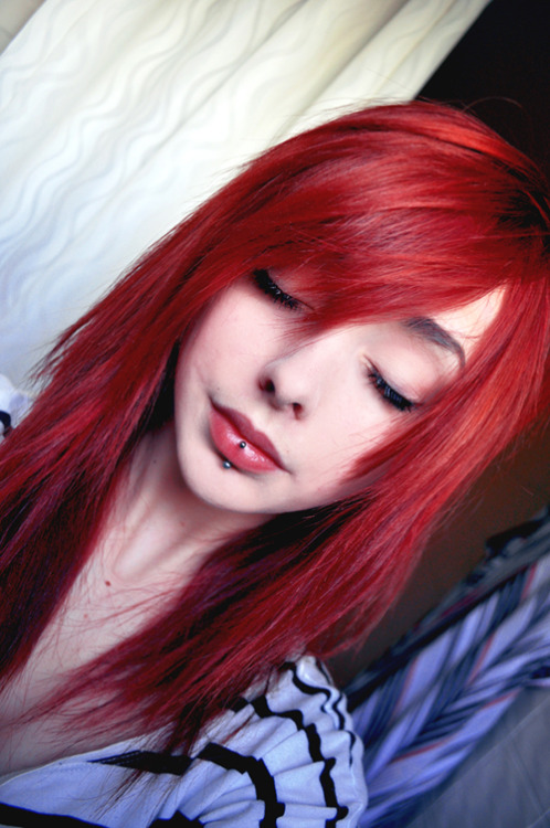Johanna Herrstedt, with a piercing and awesome red hair. You will also like: glamour photography.Nobody else.