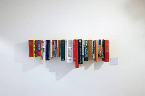 cruisecontrolforcool:  a book shelf!  for books, even!  a book bookshelf!  A bookshelf made of books! I can't help but feel that this is a little sacrilegious.