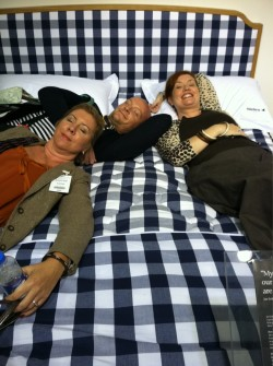 #DesignTV a few BlogTour attendees grab a quick nap at the Hastens showroom during Decorex 2011 - it was wonderful to meet the PR people for Hastens too.