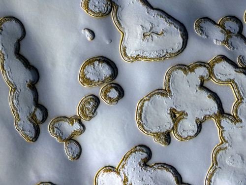 (via APOD: 2011 September 26 - Dry Ice Pits on Mars)