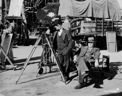 Buster Keaton and Edward Sedgwick on the set of The Cameraman