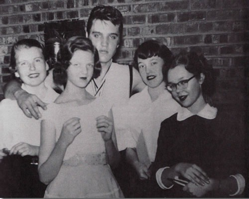 Elvis Presley with fans (1956)