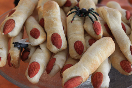 truebluemeandyou:  DIY Creepy Lady Fingers. I have really stopped posting food because even though there is a lot of Halloween stuff out there (like the bleeding spider cupcakes) I am too lazy to make it. But when I found these on Living Locurto here, they were so easy that even I would make them. Use Pillsbury bread stick dough and add almonds. More details at her site that also has mummy hot dogs and a kind of scary mummy meat loaf.