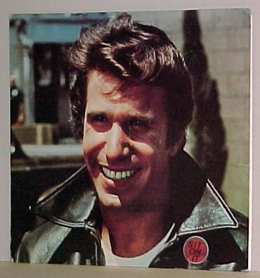 "The Fonz may not have been swigging PBR or discussing the finer points of chillwave, but rest assured that this greaser, created amid the '70s mania for '50s nostalgia, was an early hipster nonetheless — especially when you consider the prototype Norman Mailer presented in his 1957 essay ""The White Negro."" A former teen gang member with a heart of gold, he is the sole leather-jacketed cool guy in a world of letterman-sporting jocks and geeks with Coke-bottle glasses. Hell, there's even an xBxRx song named after him.  (via Flavorwire » Hipsters on TV: A Retrospective from Fonzie to 'Portlandia')"