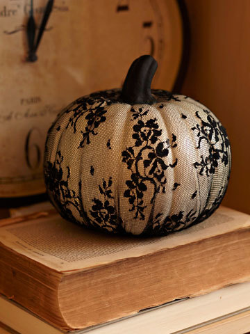 cover a metallic spray painted pumpkin w/ lacy tights for chic fall decor!
