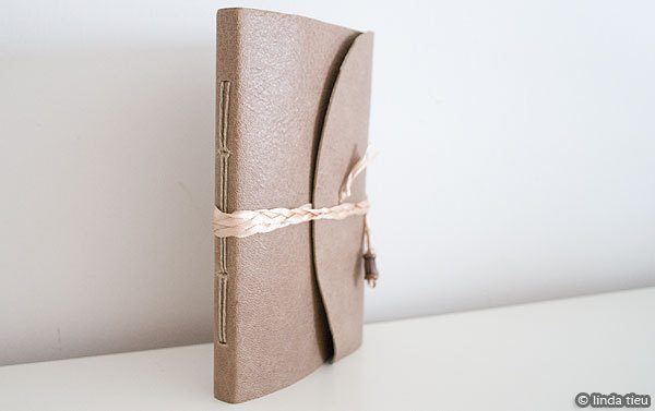 Simple book binding tutorial, I would love to try this: http://www.tortagialla.com/2010/08/09/longstitch-bookbinding-tutorial-for-a-leather-journal/